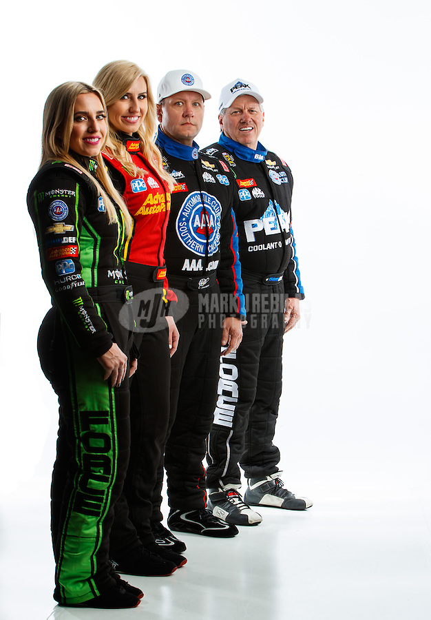 Feb 8, 2017; Pomona, CA, USA; (From left) NHRA top fuel driver Brittany Force , funny car driver Courtney Force , Robert Hight and John Force pose for a portrait during media day at Auto Club Raceway at Pomona. Mandatory Credit: Mark J. Rebilas-USA TODAY Sports