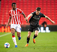31st October 2020; Bet365 Stadium, Stoke, Staffordshire, England; English Football League Championship Football, Stoke City versus Rotherham United; John Obi Mikel of Stoke City under pressure from George Hirst of Rotherham United