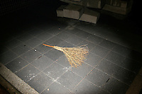 CHINA. Beijing. A brush lying on the sidewalk. 2008