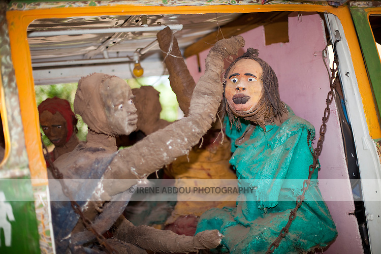 """Exhibit of a """"bush taxi"""" loaded with passengers and cargo at the National Museum of Mali in Bamako."""
