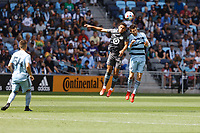 ST. PAUL, MN - AUGUST 21: Hassani Dotson #31 of Minnesota United FC and Ilie Scanchez #6 of Sporting Kansas City go for the header during a game between Sporting Kansas City and Minnesota United FC at Allianz Field on August 21, 2021 in St. Paul, Minnesota.