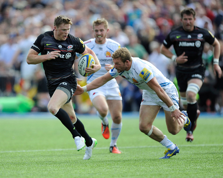 Chris Ashton of Saracens attempts to accelerate past Matt Jess of Exeter Chiefs