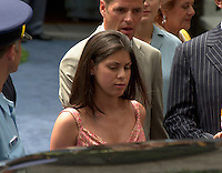 Rene Angelil daughter and her boyfriend ; Quebec humorist Marc Dupre(behind)get into a limo after Angelil  youngest  son;  Rene Charles baptism, July 25th 2001 at the Notre Dame Basilica in Montreal, CANADA.