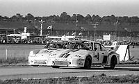 #4 Porsche 935 of  Reinhold Jöst, Rolf Stommelen, and Volkert Merl, 46th place, and #51 Porsche Carrera RSR of Robert Kirby, John Hotchkis, and Howard Meister , 36th place,  24 Hours of Daytona, Daytona International Speedway, Daytona Beach, FL, February 1979. (Photo by Brian Cleary/bcpix.com)