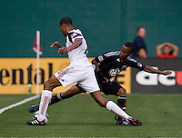 Thabiso Khumalo (17) of D.C. United reaches to take the ball away from Chris Schuler (28) of Real Salt Lake during a U.S. Open Cup tournament game at RFK Stadium in Washington, DC.  D.C. United defeated Real Salt Lake, 2-1, in overtime.