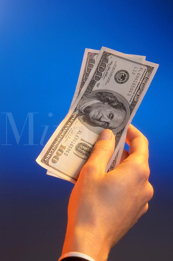 A businessman handing over bills.