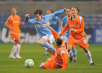 Red Stars player Megan Rapinoe pushes the ball against the Sky Blue FC defense during their game. Sky Blue FC tied Chicago Red Stars 0-0 on April 19, 2009.
