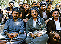 Iraq 1999  <br /> In Rowanduz, sitting In the middle, Nowzad Khoshnaw, left, Serhat Khoshnaw and right, Sheikh Abdel KhalakNowzad and behind, their body-gards <br /> Irak 1999 <br /> Anwar Beg Khoshnaw au milieu assis , a gauche Serhat Anwar Beg Khoshnaw et a droite Sheikh Abdel Khalak a Rowanduz avec au fond leurs garde-corps