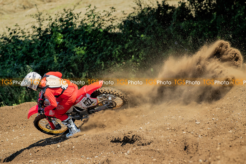 Brett Fisher accelerates out of the turn (South Eastern EVO during the Richard Fitch Memorial Trophy Motocross at Wakes Colne MX Circuit on 18th July 2021