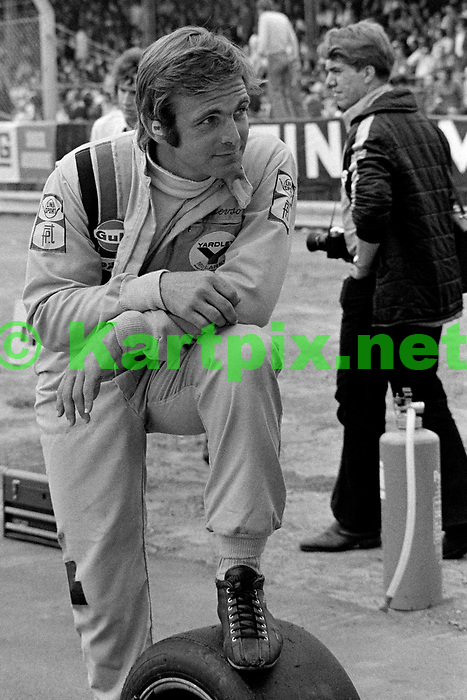 A relaxed looking Peter Revson on the grid at the chaotic 1973 British Grand Prix, he went on to win the race,<br /> Revson was the heir to the Revlon cosmetics fortune.