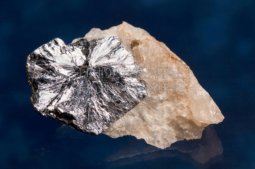 MOLYBDENITE ON QUARTZ<br /> From Molly Hill Mine,  Quebec, Canada<br /> Molybdenite occurs in hydrothermal deposits of ore. Similar in appearance to graphite, it has a lubricant feel due to its layered structure. This structure contributes to its characteristic cleavage planes.