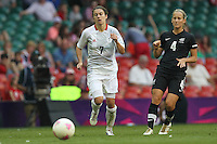 Karen CARNEY of Great Britain and Katie HOYLE of New Zealand - Great Britain Women vs New Zealand Women - Womens Olympic Football Tournament London 2012 Group E at the Millenium Stadium, Cardiff, Wales - 25/07/12 - MANDATORY CREDIT: Gavin Ellis/SHEKICKS/TGSPHOTO - Self billing applies where appropriate - 0845 094 6026 - contact@tgsphoto.co.uk - NO UNPAID USE.