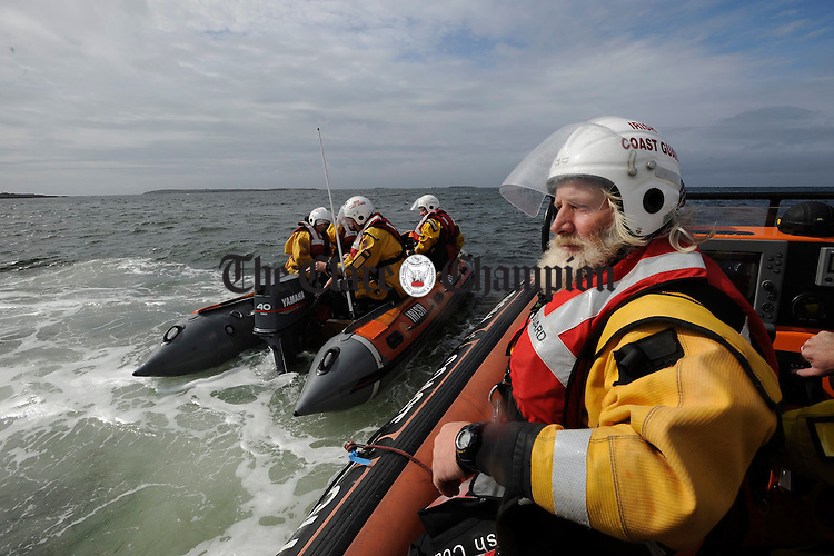 Tom Doherty, Deputy Area Officer with the Doolin Unit of the Irish Coastguard co-ordinating the safety of all competitors at the Leon Currach Regatta at Seafield, Quilty. Photograph by John Kelly.