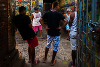 "Colombian sign painters hang out in the sign painting workshop in Cartagena, Colombia, 12 December 2017. Hidden in the dark, narrow alleys of Bazurto market, a group of dozen young men gathered around José Corredor (""Runner""), the master painter, produce every day hundreds of hand-painted posters. Although the vast majority of the production is designed for a cheap visual promotion of popular Champeta music parties, held every weekend around the city, Runner and his apprentices also create other graphic design artworks, based on brush lettering technique. Using simple brushes and bright paints, the artisanal workshop keeps the traditional sign painting art alive."