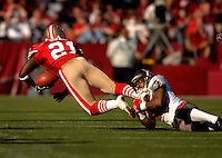 Oct 30, 2005; San Francisco, CA, USA;  San Francisco 49ers running back #21 Frank Gore is tackled by Tampa Bay Buccaneers cornerback #20 Ronde Barber in the second quarter at Monster Park. Mandatory Credit: Photo By Mark J. Rebilas