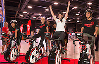 Sarah Walker, celebrates a win after racing bikers in a WattBike power challenge with from left, Eileen Hauraki, 15, Suzy Clarkson (Coca Cola Corporate Affairs Manager) and Charley-Casey Jackson, 13, (both girls from Tokoroa), at the launch of the Move60 app at Mystery Creek Events Centre, Hamilton, New Zealand, Saturday 29 March 2014. Photo: Stephen Barker/Barker Photography. ©www.lintottphoto.co.nz