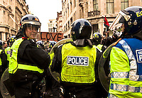 Police officer - 2011<br /> <br /> London, 26/03/2011. The 2011 anti-cuts protest in London organised by the TUC (Trade Union Congress) saw around 500,000 people gather and march in central London. The march was called against the spending cuts being made by the Coalition Government (Conservative party and Liberal Democrats party). The main rally started from Victoria Embankment, and marched through Parliament Square and Whitehall, before terminating in Hyde Park. However, during the day splinter groups of protesters staged direct actions at shops such as Fortum & Mason, and several banks. Police forces heavily armed with riot control equipment tried to contain the crowds and several times used the kettling tactic. The West End first (Soho, Oxford Circus, Piccadilly Road, Piccadilly Circus, and nearby locations), then Trafalgar Square later in the evening, were the main locations of clashes between police officers and protesters.  The day of protests ended with 201 people arrested and more than 60 injured.