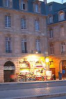 On Les Quais. Night grocery shop. Bordeaux city, Aquitaine, Gironde, France