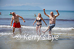 Enjoying the day on Ballyheigue beach as they cool down on Sunday, l to r:  Maurice Dunnesworth, Darren Barrett and Nicola O'Connor.