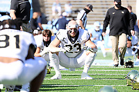 CHAPEL HILL, NC - NOVEMBER 14: Brandon Chapman #23 of Wake Forest stretches before a game between Wake Forest and North Carolina at Kenan Memorial Stadium on November 14, 2020 in Chapel Hill, North Carolina.