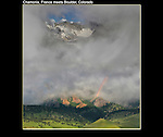 Photo-composite of French Alps, Flatirons rock formation and some weather.  John is an expert in using and teaching Photoshop and Lightroom software.
