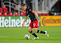 WASHINGTON, DC - MAY 13: Drew Skundrich #12 of D.C. United dribbles the ball during a game between Chicago Fire FC and D.C. United at Audi FIeld on May 13, 2021 in Washington, DC.