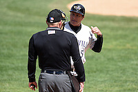 Louisville Bats manager Jim Riggleman (5) argues a call with home plate umpire Jonathan Bailey, which he was ejected for, during a game against the Rochester Red Wings on May 4, 2014 at Frontier Field in Rochester, New  York.  Rochester defeated Louisville 12-6.  (Mike Janes/Four Seam Images)