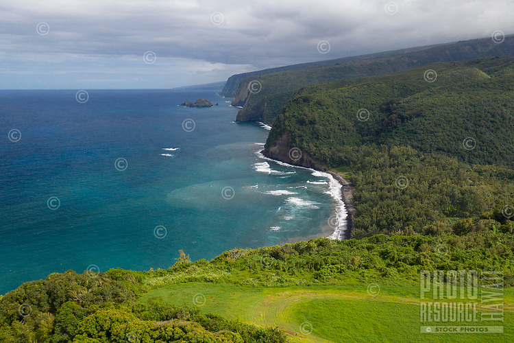 An aerial view of Pololu Valley and its black sand beach in North Kohala, Big Island of Hawai'i.