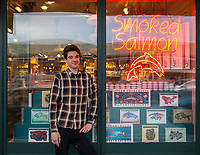Smoked Salmon Storefront & Employee, Pike Place Market, Seattle, WA, USA.