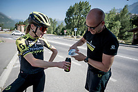 on their way to the bottle point, the Mitchelton-Scott crew bounce into Annemiek van Vleuten (NED/Mitchelton-Scott) who is training in the neighbourhood <br /> <br /> Stage 18: Embrun to Valloire (208km)<br /> 106th Tour de France 2019 (2.UWT)<br /> <br /> ©kramon