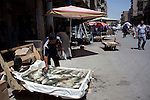 BAGHDAD, IRAQ: A man sells fish in the old Shorja market in Baghdad...Despite an increase in violence across Iraq, daily life continues as normal in Baghdad...Photo by Ali Arkady/Baghdad
