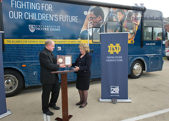Oct. 2, 2013; Rev. Tim Scully, C.S.C., co-founder of the Alliance for Catholic Education (ACE) presents Texas State Senator Jane Nelson the University of Notre Dame Champion For Education Award at an event outside her office in Grapevine, Texas.<br /> <br /> Photo by Matt Cashore/University of Notre Dame