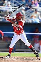 Batavia Muckdogs outfielder Kevin Grove (12) at bat during a game against the State College Spikes on June 22, 2014 at Dwyer Stadium in Batavia, New York.  State College defeated Batavia 10-3.  (Mike Janes/Four Seam Images)