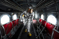 130510-N-DR144-416- PACIFIC OCEAN (May 10, 2013)- Damage Controlman 3rd Class Carson Seitz searches the interior of a CH-46 Sea Knight while training to rescue injured aircrew during flight deck drills aboard San Antonio-class amphibious transport dock ship USS Anchorage (LPD 23).  Anchorage is underway after being commissioned in its namesake city of Anchorage, Alaska. (U.S. Navy photo by Mass Communication Specialist 1st Class James R. Evans / RELEASED)