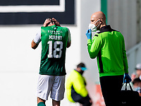 28th August 2021;  Easter Road , Leith, Edinburg, Scotland; Scottish Premier League football, Hibernian versus Livingston; Jamie Murphy of Hibernian holds his head in this hands in frustration after an injury