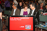 INDIANAPOLIS, IN - January 18, 2013: 1991 World Cup captain and 2003 World Cup coach April Heinrichs (center) talks to 1991 World Cup coach Anson Dorrance (right). With 1995 and 1999 World Cup coach Tony DiCicco (left). U.S. Soccer hosted a World Cup Coaches and Captains panel at the Indiana Convention Center in Indianapolis, Indiana during the NSCAA Annual Convention.