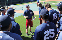 Hitting coach Darren Fenster of the Greenville Drive talks with his position players before a game against the Lakewood BlueClaws on April 7, 2012, at Fluor Field at the West End in Greenville, South Carolina. (Tom Priddy/Four Seam Images)