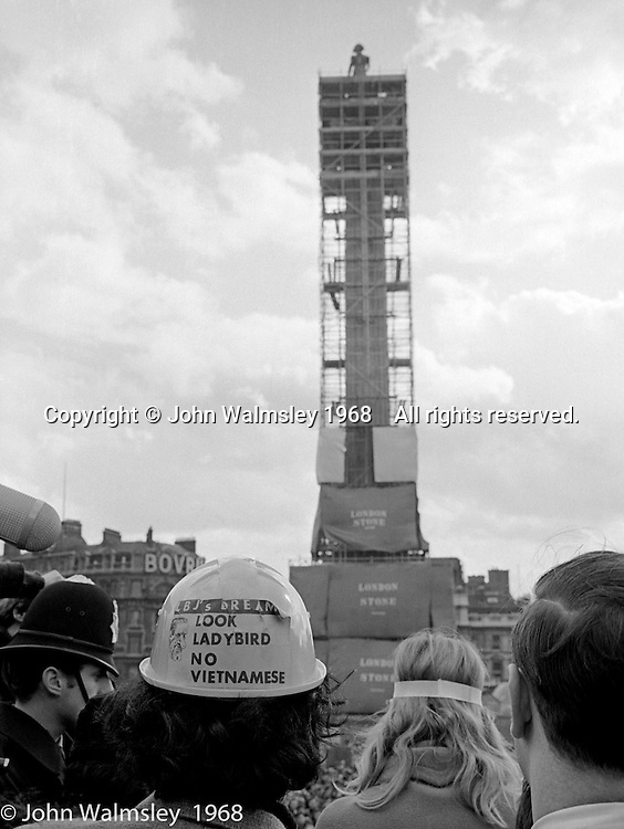 Tariq Ali (hard hat) and Vanessa Redgrave (headband) addressing the crowds, anti-Vietnam war demonstration march from Trafalgar Sq to Grosvenor Sq Sunday 17th March 1968.  I was told the headband was a Vietnamese sign of mourning for dead children.
