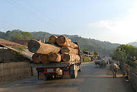 LAO PDR, Phonsavan, truck with timber logs on the road / Indochina Laos, Laster mit Holzstaemmen