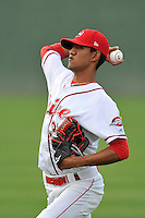 Starting pitcher Roniel Raudes (34) of the Greenville Drive warms up before a game against the Charleston RiverDogs on Tuesday, May 17, 2016, at Fluor Field at the West End in Greenville, South Carolina. Greenville won, 4-2. (Tom Priddy/Four Seam Images)