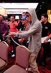 Yoshihiro Tasaka celebrates with a supporter after winning a big pot.