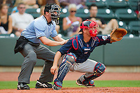 Catcher Tim Federowicz #18 of the Salem Red Sox sets a target as home plate umpire Chris Graham looks on during a Carolina League game against the Winston-Salem Dash at  BB&T Ballpark June 27, 2010, in Winston-Salem, North Carolina.  Photo by Brian Westerholt / Four Seam Images
