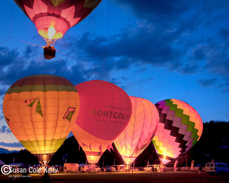 The sunset Balloon Glow at the Quechee Hot Air Balloon Festival in Quechee village, Hartford, VT, USA