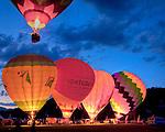 The sunset Balloon Glow at the Quechee Hot Air Balloon Festival in Quechee village, Hartford, VT, USA