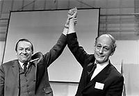 """ARCHIVE -<br />  Congres du Mouvement Souvrainetee-ssociation - Rene Levesque et les membres du nouveau parti Quebecois <br /> Date : Entre le 13 et le 19 octobre 1969<br /> <br /> Sur la photo: Gilles Gregoire est félicite pour avoir propose et remporte le choix de la majorité qui ont choisi de nommer le nouveau parti, """"Parti Québécois"""". Rene Levesque qui n'aimait pas ce nom, n'a d'autre choix que d'accepter le vote de la majorité<br /> <br />  PHOTO :  © Agence Québec Presse, Fonds Photo Moderne"""