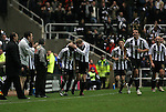 Newcastle United 2 Watford 1, 16/12/2006. St James Park, Premier League. Newcastle United take on Watford (yellow shirts) in a Premiership match at St. James' Park, Newcastle. Both teams were struggling near the bottom of the table with the newly-promoted visitors occupying one of the three relegation at the time of the match. Newcastle won by 2 goals to 1, both being scored by Obafemi Martins. Hameur Bouazza had equalised before United's late winner. Photo shows United players celebrating the winning goal in front of Watford manager Aidy Boothroyd. Photo by Colin McPherson.