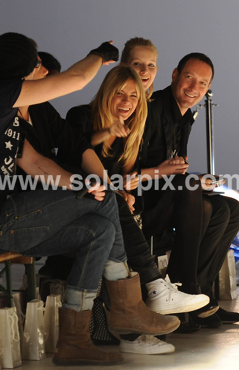 **ALL ROUND PICTURES FROM SOLARPIX.COM**.**NO UK NEWSPAPER PUBLICATION**.**UK MAGAZINE & SUPPLEMENT PUBLICATION ONLY** AND NO PUBLICATION IN AUSTRALIA, FRANCE, GERMANY, ITALY AND SCANDINAVIA** .Actress Sienna Miller presents her debut catwalk collecton - Twenty8Twelve - at London Fashion Week. London, UK. 22 February 2009..This pic: Sienna Miller..JOB REF: 8531 SFE       DATE: 22_02_2009.**MUST CREDIT SOLARPIX.COM OR DOUBLE FEE WILL BE CHARGED**.**ONLINE USAGE FEE  GBP 50.00 PER PICTURE - NOTIFICATION OF USAGE TO PHOTO @ SOLARPIX.COM**