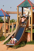 Tripoli, Libya, North Africa - Friday Afternoon in the Public Park, Playground, near the Green Square.  Children on Slide.
