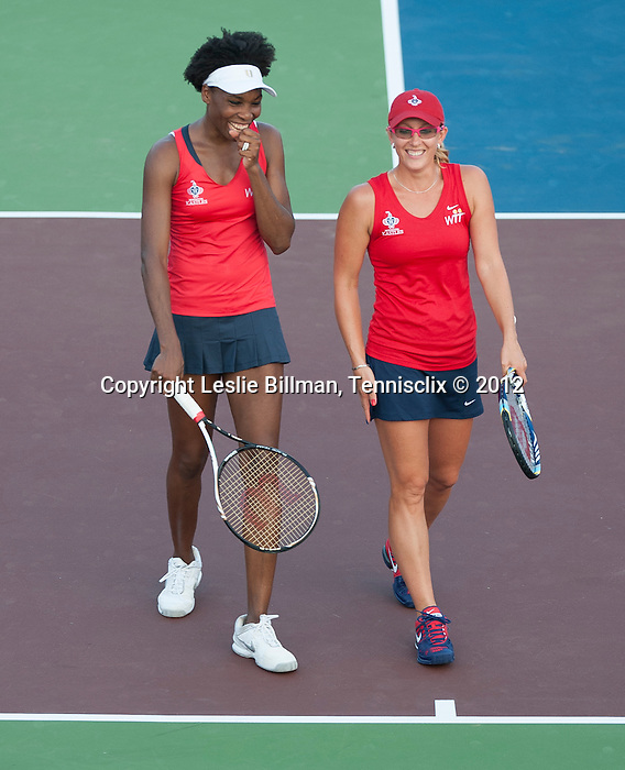 Venus Williams (white cap) and Anastasia Rodionova of the Kastles play at the World Team Tennis match between the Washington Kastles and the Boston Lobsters on July 16, 2012 in Washington, DC.
