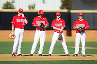 (L-R) Alexander Lee (33), Hunter Higgerson (3), Chris Coia (2) and Josh Gardiner (10) wait for their new pitcher to finish his warm-up tosses during the game against the Missouri Tigers at Wake Forest Baseball Park on February 21, 2014 in Winston-Salem, North Carolina.  The Tigers defeated the Highlanders 15-3.  (Brian Westerholt/Four Seam Images)